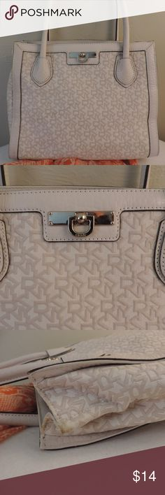 """DKNY Off white purse handbag For the most part this bag is gorgeous! There is some staining around the top rim and a slight mark on the body of the back. I don't think this bag was ever used. The silica gel packs are still inside. I think it has just been stored improperly which led to the staining.  Measures 12.5 long and 10"""" high. Dkny Bags Shoulder Bags"""