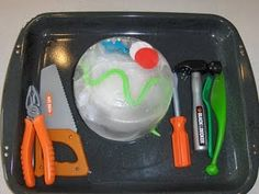 Freeze small objects in a plastic container and then have the kiddo excavate them. Great for a hot summer day! Love this idea!!