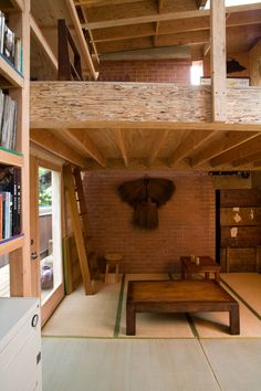 Interior. Check out the bookshelves and cool loft.