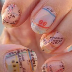 paint your nails white and then dip them in alcohol and then press on a subway map onto each nail and the alcohol transfers the print onto your nail.
