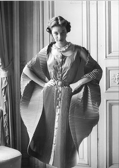 1951, Finely Plisséd Dress opened into a Cocoon, by Elsa Schiaparelli.