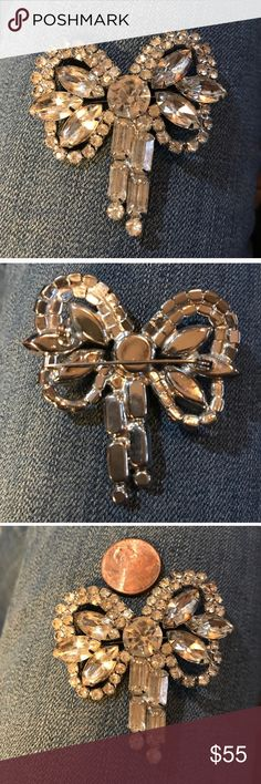 VTG EXQUISITE BROOCH This is an eye catcher! Stunning floral (or bow) with large center rhinestone surrounded by petals and princess cut stones bezel set in the stem. This piece is unmarked. Any questions please ask! Remember to bundle for additional savings 💞 Tx for browsing! Marian 🌹 Vintage Jewelry Brooches