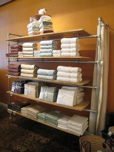Industrial Style Shelving used as a retail display for bathroom towels.