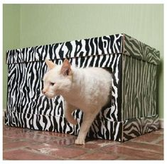 This Litter Box Cover Could Be Easy DIY- would be cute to do in a print. Like filigree or something.