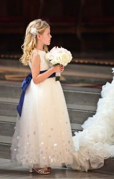 The flower girl: dark blue sash over a white dress. #dawninvitescontest