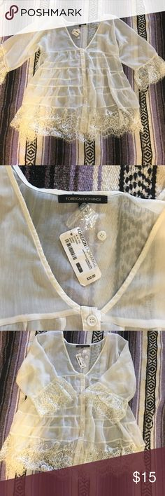 Boho, Flowy Top Boho, Flowy, Lace Top. Purchased at Foreign Exchange, never worn. This would be perfect as a swimsuit cover up or with a pair of jeans and booties. Looks like it could be Free People. Free People Tops Blouses