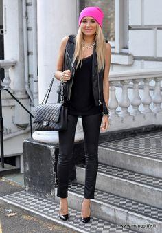 Hot pink beanie, black leather moto vest, basic top, wet look leggings, black bag and heels