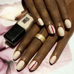 Once the bright white shades of summer have disappeared from our nails, it's time to aim for something a little warmer. Try a beautiful beige color, then achieve the world's easiest nail art by drawing a thin, single line down one nail per hand. Click through for more stunning fall nail art ideas.