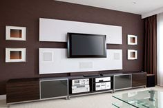 Photo about Modern Home Theater Room Interior with Flat Screen TV, brown wall. Image of furnished, furniture, home - 31863397 Hide Cables On Wall, Hide Wires, Hiding Cables, Installation Home Cinema, Home Cinema Systems, Tv Cabinet Design, Modern Tv Wall Units, Hidden Tv, Muebles Living