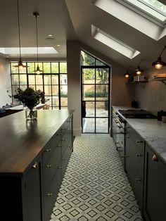 Bespoke kitchen by 202 design with Queens Park Design & Build. Painted Shaker, farrow & Ball Railings, Carrara Marble, brass, Lacanche range, solid Oak. Waterworks Brass Tap. Crittal doors