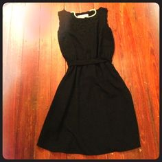 """Black dress Black scalloped dress from Loft size Zero. I usually wear a four but this dress for me but has grown a little tight. Cutout on the chest. Hits above the knees (I'm 5'8""""). Smoke free home. Elastic at waist and ties around as well. No zippers. LOFT Dresses Midi"""