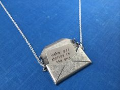 """Matt Smith Karen Gillan 11th Doctor Amy Pond Doctor Who Inspired Hand Stamped Handmade Silver envelope hidden letter message necklace. It is hand stamped with the quote, """"we're all stories in the end just make it a good one"""". Very proud of this ORIGINAL design. I make these by hand and ship them from Maryland, USA. Check out my other DW jewelry and crafts on my Pinterest page!"""
