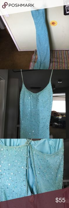 Teal sequence prom dress Long, sequenced with a slit down the side. Slim fitting. Spaghetti strap Dresses Prom