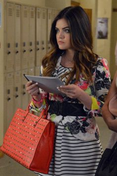 Aria is a total pro when it comes to mixing prints. Even when she's mixing two classic prints—florals and stripes—Aria adds a bold, fashion-y twist with pops of neon on her jacket and a studded orange bag.   - Seventeen.com