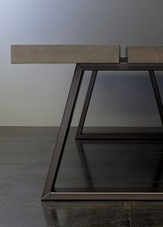 /—/ nosara Distinctive dining table with a solid wood top and a base made from.