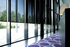 Reduce glare in the office with Solar Shades. Shown in material 7% Metallic, color Peat. | The Shade Store