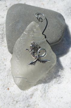 Genuine frosted sea glass Christmas ornaments with silver mermaid charm. Dress up your Christmas tree and bring memories of warm summer nights and
