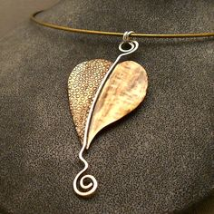 Modern Bronze Leaf Pendant with sterling silver by CityRusticJewelry via Etsy