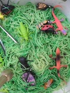 """we can do all things: fine motor activities ... finding bugs in spaghetti """"grass"""" using tongs, big spoons and of course hands"""