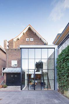 Woonhuis - Vught www.burokoek.nl/ Baksteen - Stalen kozijn - Zwart kozijn - Beton vloer - Aanbouw- Vide - Gerecycled trap - Glas