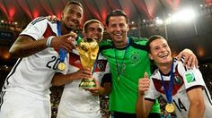 Philipp Lahm of Germany holds the World Cup to celebrate