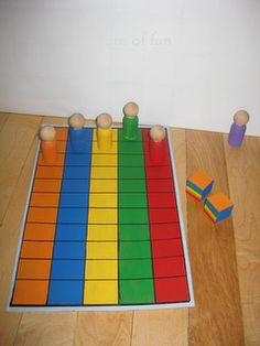 Peg People Race Game - I would love to attach some velcro and pictures of the kids.