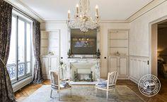 Flat screen TV above fireplace at Quai Royal, apartment for rent in Paris, Marais