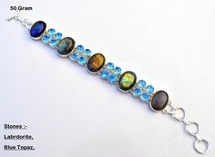 Dear buyer, If you like any item at your first look then just grab it because i believe that first look is always a heart look, So before any other buyer just purchase it :-)  ===========================================================  This is my Handmade Premium Quality 925 Sterling Silver 50 Gram Bracelet With Flashy Labradorite,Blue Topaz,Gemstone,Best For Gift  =========================================================  Weight :- 50 Gram  Bracelet Size (Approx) :- 7 to 10 Inches With…