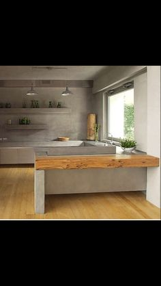 Pin 1: This kitchen features concrete walls with concrete shelving and bench tops which is paired beautifully with natural timber floors and bench.