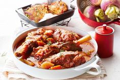 For a hearty meal the whole family will enjoy, serve tender lamb shanks in a rich tomato stew with a side of golden potato cakes.