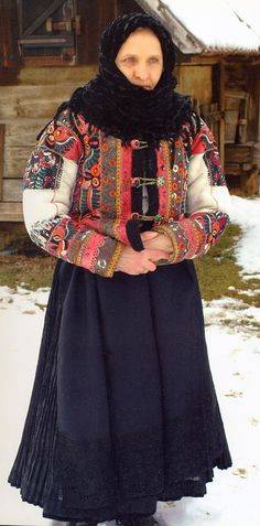 Europe - Hungary, At first glance, this woman seems to be wearing a plain black apron, but in fact, the lower panel has typical Matyo embroidery in black on black. Historical Costume, Historical Clothing, Folk Clothing, Folk Costume, Costume Dress, Black Apron, Costumes Around The World, Hungarian Embroidery, Folk Dance