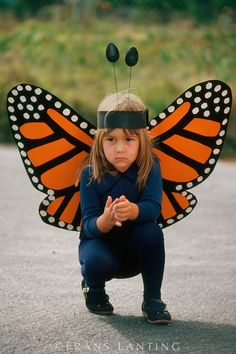 Young girl at monarch butterfly parade, Pacific Grove, California