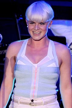 Is that Miley's haircut? Looks like it! Robyn has been sporting her signature bleach blonde, short sides, long bangs look for years. The stylemaker performs at MTV's O Music Awards 2 on October 31, 2011 in West Hollywood.