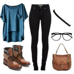 Blue loose slightly cropped top, high waisted black skinny jeans, leather accessories.
