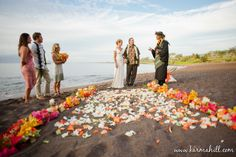 Jean and Richard exchange their vows at Makena Black Sand Beach. Wedding planned by Tori Rogers at Hawaii Weddings by Tori Rogers. Photo by Karma Hill. Flowers by Dellables.  http://www.hawaiianweddings.net #MakenaBeach #Makenablacksandbeach #makenaweddings #Mauibeaches #Mauiweddingplanner #Mauiwedding #Mauiweddings #Mauibeacweddings #sunsetwedding #Blacksandbeach #petalpath #weddingflowers #hawaiianweddings