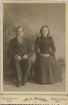 Cabinet Photo Couple Castle Background Beard Sausage Curls by H C Bobb IL Wi | eBay.  The bottom of the photo says Orangeville, IL & Monticello, Wis.,  the photographer was H.C. Bobb.  The man's beard almost looks Pennsylvania Dutch to me.