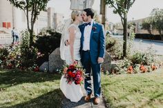 Modern Romantic Cleveland Wedding at Redspace, red bouquet by Fair Rarity Flowers