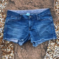 """Old Navy Cut-Off Jean Shorts Old Navy Cut-Off Jean Shorts - Classic 5 pocket styling. Button waistband with zip fly. 98% Cotton, 2 % Spandex. 3.5"""" inseam. EUC. Size 10. Trades Modeling Pics. Old Navy Shorts Jean Shorts"""