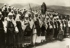 Dozens of women in ornate traditional dress armed with rifles. Greek Traditional Dress, Traditional Outfits, National Geographic Images, Old Greek, Folk Costume, Image Collection, Greece, Arms, Photo And Video