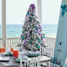 Put a Ribbon On It - Use contrasting colors, like lilac ribbon and turquoise ornaments, to create your own unique color scheme. Match place settings and presents to tie the room together