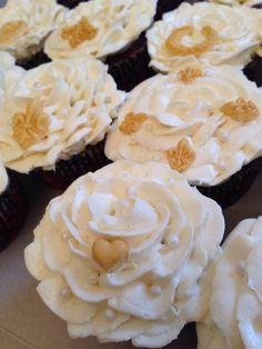 Red velvet cake with cream cheese Icing flower cupcakes with gold Decor