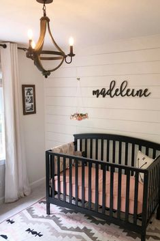 How to create the perfect baby girl's nursery. Black, cream, and peach nursery. Shiplap, wine barrel chandelier nursery inspiration.