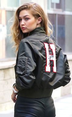 Gigi Hadid from The Big Picture: Today's Hot Pics The model is spotted rocking a custom bomber jacket with her name embroidered on it during a photoshoot for Tommy Hilfiger in Soho, New York City.