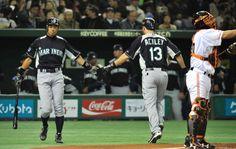 Seattle Mariners player Dustin Ackley celebrates his solo home run with teammate Ichiro Suzuki