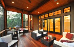 Neal Prince Studio | South Falls Road | The Reserve at Lake Keowee  Comfortable and contemporary screened porch, rich with wood ceilings and deck