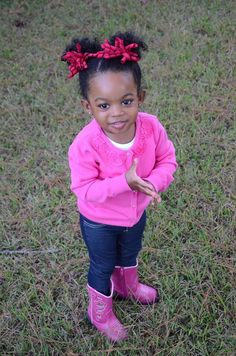 Zaria, pretty in pink sweater and boots