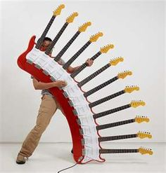 Guitar fans, have you ever seen such an unusual 12-necked guitars? The sculptures guitars are made by Japanese artist Yoshihiko Satoh which took six months to build, known as the most difficult musical instruments to play in the world. The guitars have sold for 100,000+.