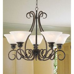Bring elegance and a slight formality into your dining room with this contemporary twist to a traditional hanging chandelier. This chandelier has five lights, each of which has an opaque white shade and requires a 60-watt light bulb.