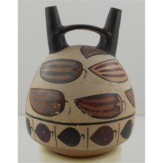 Nazca pottery, double spout bridged with pepper pattern. Pinned by Gilbert de Jong.