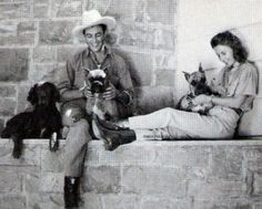 robert Taylor and barbara Stanwyck sat with their dogs